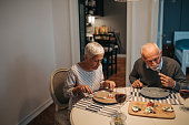A senior couple having a romantic dinner for two.
