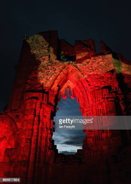 A light display illuminates the ruins of the historic Whitby Abbey on October 24 2017 in Whitby England The famous Benedictine abbey was the...
