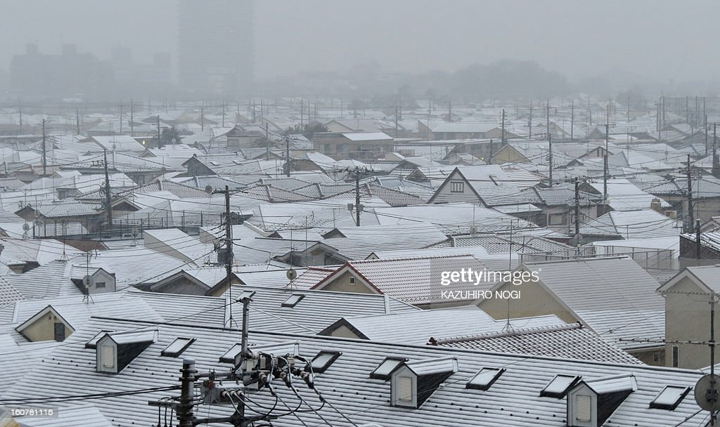 A light dusting of snow covers rooftops across a neighborhood in Tokyo on February 6, 2013. The Japan Meteorological Agency was forecasting heavy snow on Pacific coastal regions in western and eastern Japan on February 5 and February 6 as a developing low pressure system passed along the south of the Japanese archipelago.
