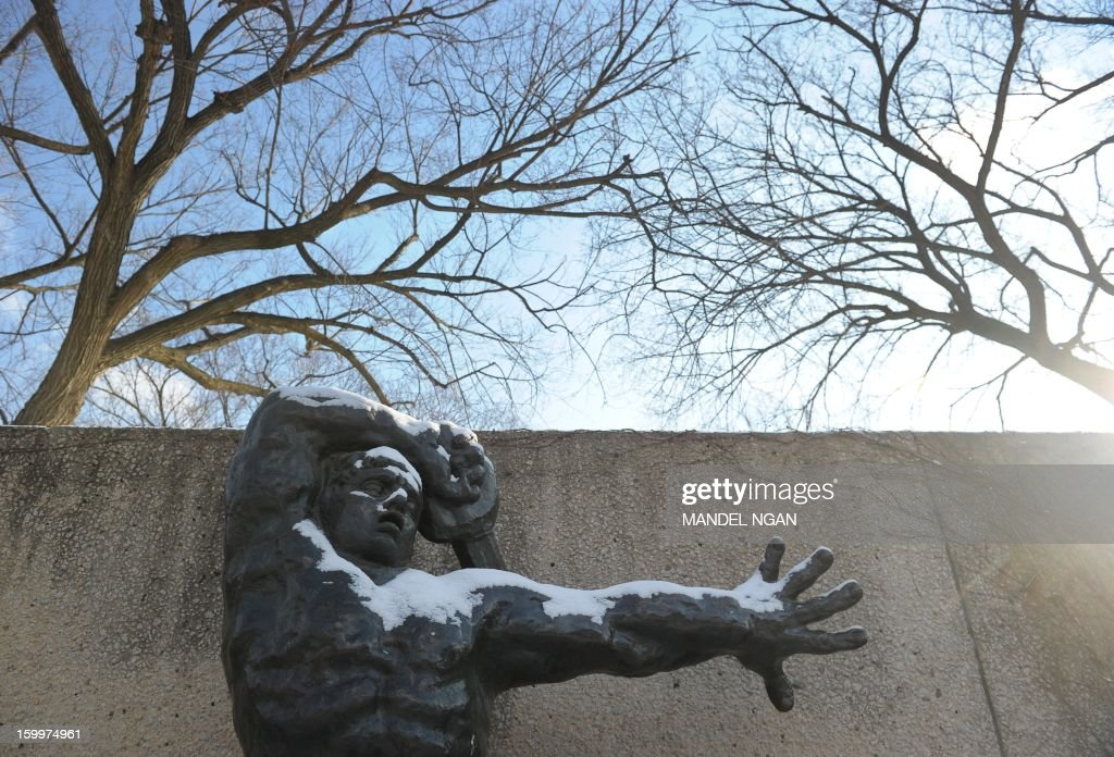 A light dusting of snow covers 'The Great Warrior of Montauban' by Emile-Antoine Bourdelle in the Hirshorn Museum sculpture garden on January 24, 2013 in Washington, DC. A light blanket of snow fell over the DC region, causing some school closures and delays. AFP PHOTO/Mandel NGAN