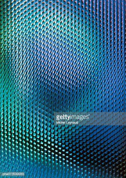 Light effect on textured surface, blues and greens, full frame