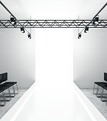 Light empty fashion runway podium stage interior with seats, lights and copyspace. 3D Rendering