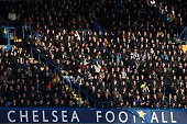 TOPSHOT Light falls across the crowd during the English Premier League football match between Chelsea and Everton at Stamford Bridge in London on...