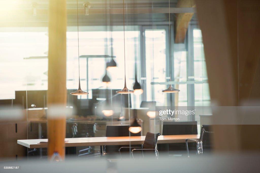 Light fixtures and desks in empty office : Stock Photo