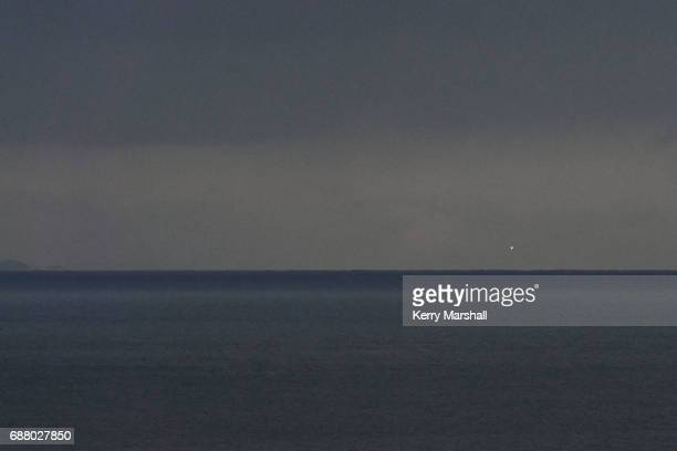 Light from the engines can just be seen from Napier 85km from the launch site as Rocket Lab lauch on May 25 2017 in Napier New Zealand After three...