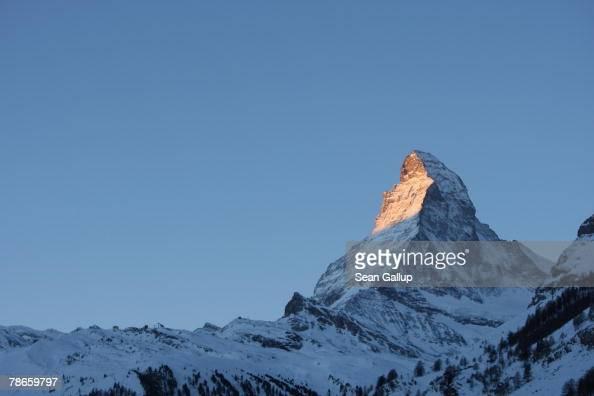 Light from the rising sun catches the eastern face of the Matterhorn in the morning of December 24 2007 in Zermatt Switzerland Zermatt and the...