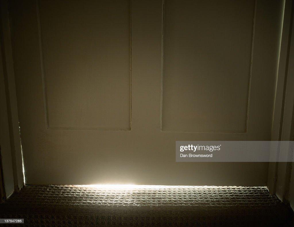 Light glowing from under door