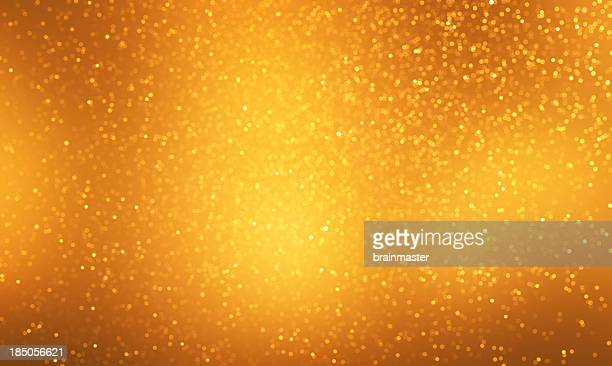 Light gold sparkles on a darker and light gold background