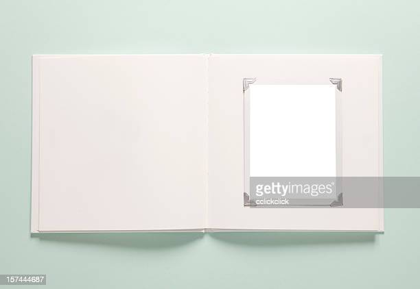 Light green background with a white empty photo album