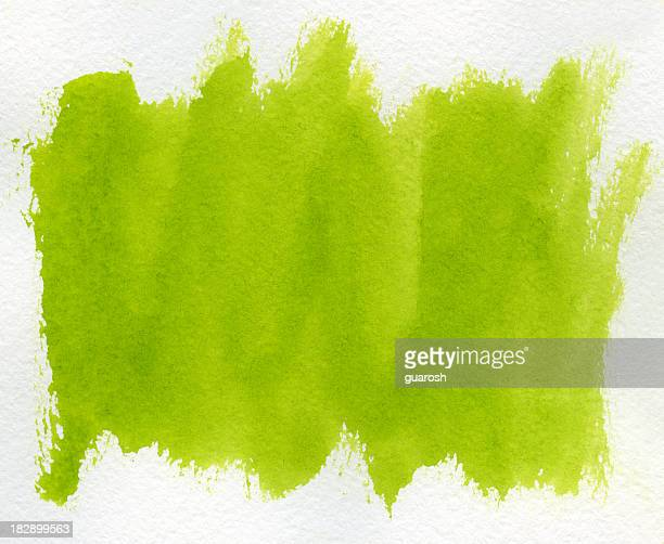 Light green paint streaks against a white background