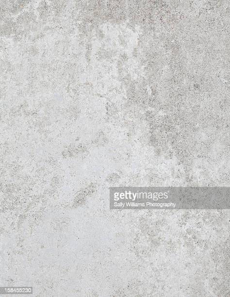 A light grey, polished concrete background
