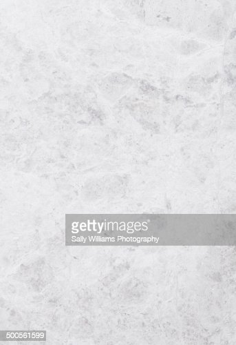 A light grey tumbled marble stone background