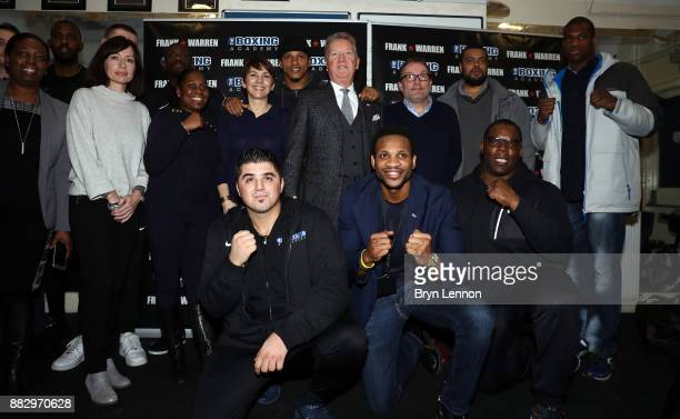 Light heavyweight boxer Anthony Yarde Boxing Promoter Frank Warren and Heavyweight boxer Daniel Dubois poses with the staff of the Boxing Academy...