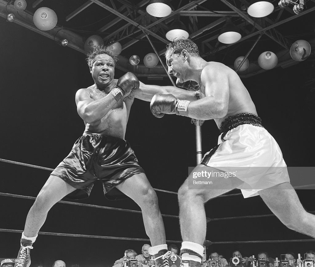Light heavyweight champion <a gi-track='captionPersonalityLinkClicked' href=/galleries/search?phrase=Archie+Moore&family=editorial&specificpeople=93092 ng-click='$event.stopPropagation()'>Archie Moore</a> (l) lands a hard left during the fifth round of his bout against heavyweight champion <a gi-track='captionPersonalityLinkClicked' href=/galleries/search?phrase=Rocky+Marciano&family=editorial&specificpeople=94011 ng-click='$event.stopPropagation()'>Rocky Marciano</a> at Yankee Stadium. Marciano successfully defended his crown by KO at 1:19 of the ninth round.