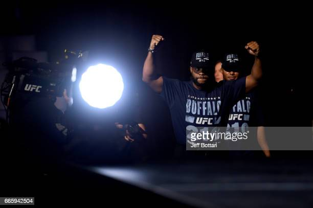 Light Heavyweight Champion Daniel Cormier walks to the stage during the UFC 210 weighin at KeyBank Center on April 7 2017 in Buffalo New York
