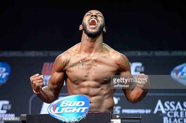 UFC light heavyweight champion Jon 'Bones' Jones weighs in during the UFC 165 weighin at the Maple Leaf Square on September 20 2013 in Toronto...