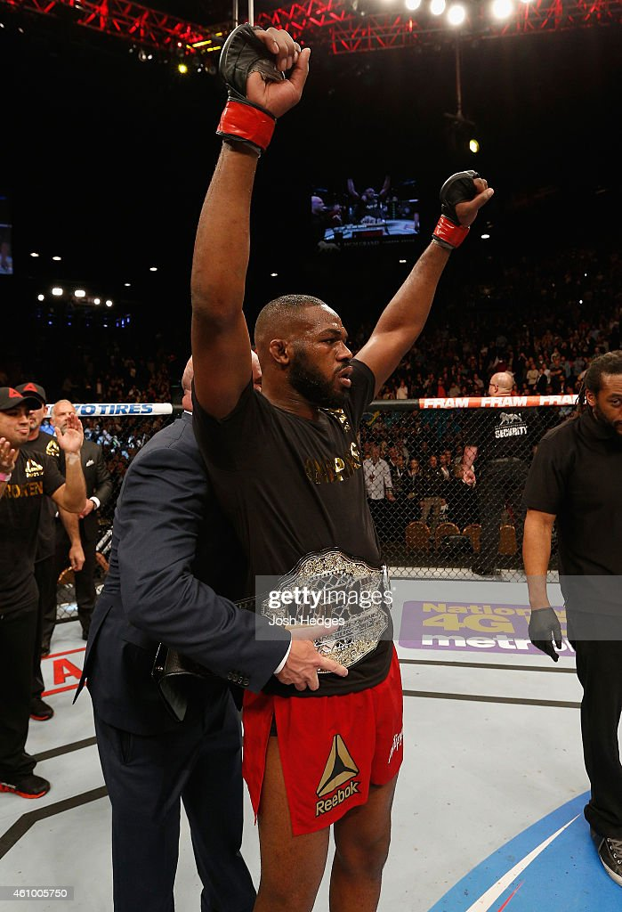 UFC light heavyweight champion Jon Jones celebrates his win over Daniel Cormier in their UFC light heavyweight championship bout during the UFC 182 event at the MGM Grand Garden Arena on January 3, 2015 in Las Vegas, Nevada.
