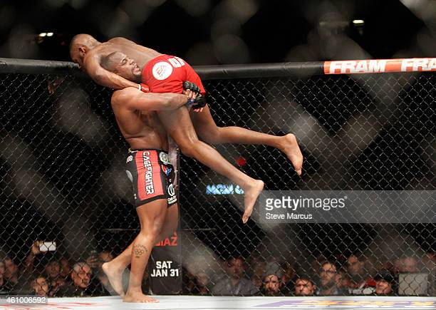 Light heavyweight champion Jon Jones is lifted up by Daniel Comier during the UFC 182 event at the MGM Grand Garden Arena on January 3 2015 in Las...