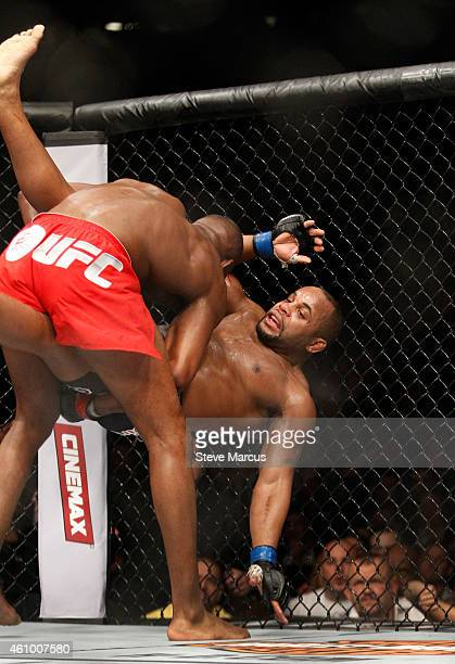 Light heavyweight champion Jon Jones throws Daniel Comier to the mat during the UFC 182 event at the MGM Grand Garden Arena on January 3 2015 in Las...