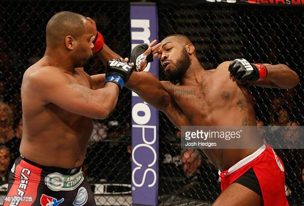 UFC light heavyweight championJon Jones punches Daniel Cormier in their UFC light heavyweight championship bout during the UFC 182 event at the MGM...