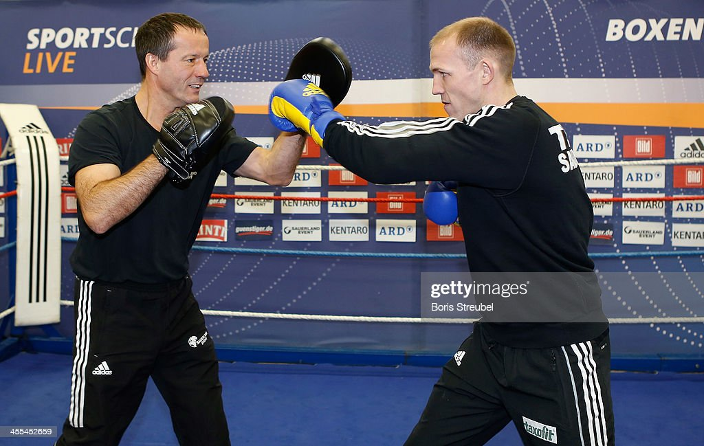 Light heavyweight fighter <a gi-track='captionPersonalityLinkClicked' href=/galleries/search?phrase=Juergen+Braehmer&family=editorial&specificpeople=608880 ng-click='$event.stopPropagation()'>Juergen Braehmer</a> (R) in action against his coach Karsten Roewer during a public training session at Sporthalle Binsenwerder on December 12, 2013 in Neubrandenburg, Germany.