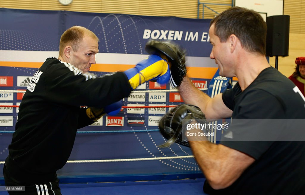Light heavyweight fighter <a gi-track='captionPersonalityLinkClicked' href=/galleries/search?phrase=Juergen+Braehmer&family=editorial&specificpeople=608880 ng-click='$event.stopPropagation()'>Juergen Braehmer</a> (L) in action against his coach Karsten Roewer during a public training session at Sporthalle Binsenwerder on December 12, 2013 in Neubrandenburg, Germany.