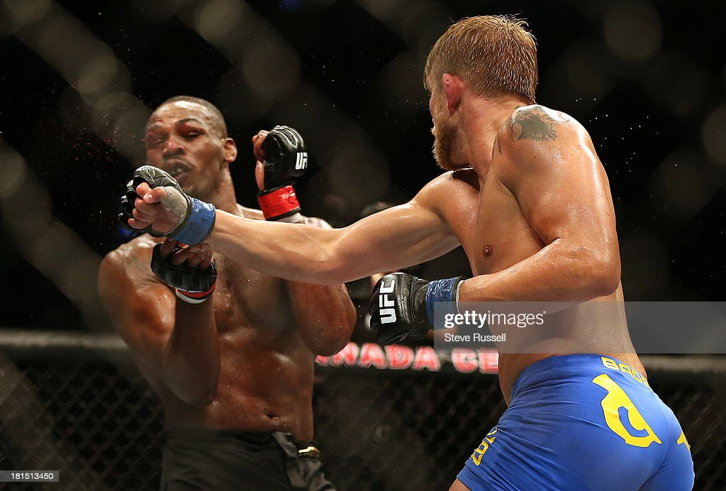 TORONTO, ON- SEPTEMBER 22 - Light Heavyweight Jon Jones gets tagged as he retains his Light Heavyweight title against Swede Alexander Gustafsson at UFC 165 at the Air Canada Centre in Toronto, September 22, 2013.