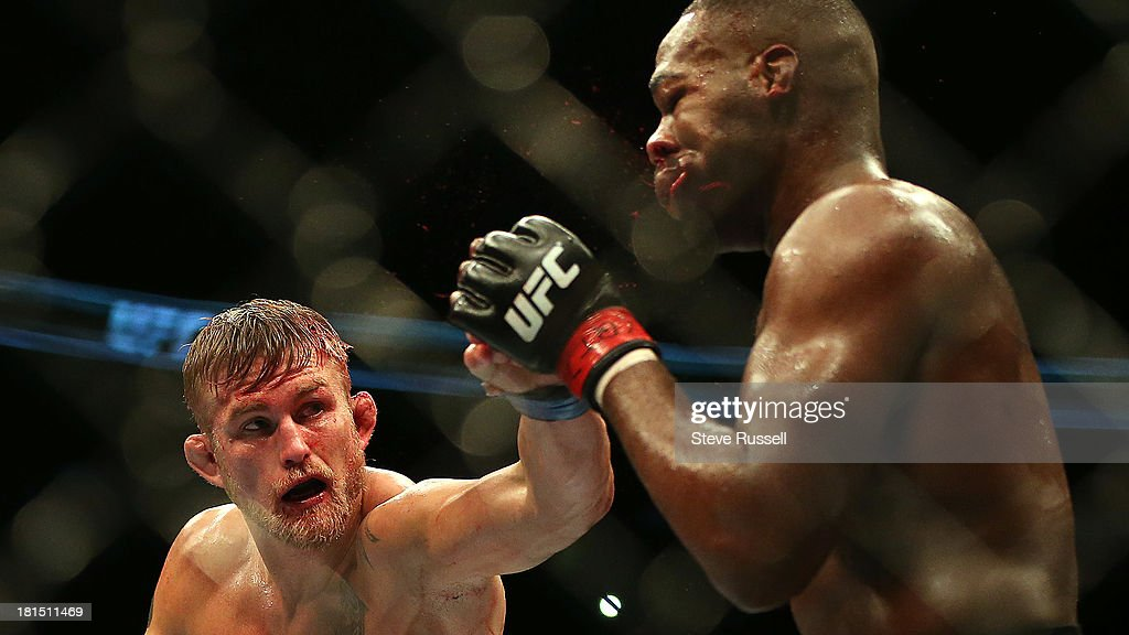 TORONTO, ON- SEPTEMBER 22 - Light Heavyweight Jon Jones gets tagged by his challenger as he retains his Light Heavyweight title against Swede Alexander Gustafsson at UFC 165 at the Air Canada Centre in Toronto, September 22, 2013.