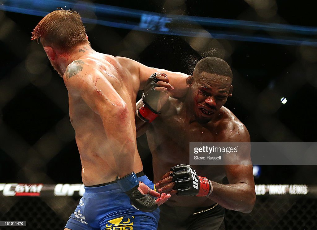 TORONTO, ON- SEPTEMBER 22 - Light Heavyweight <a gi-track='captionPersonalityLinkClicked' href=/galleries/search?phrase=Jon+Jones+-+Mixed+Martial+Artist&family=editorial&specificpeople=8928306 ng-click='$event.stopPropagation()'>Jon Jones</a> is hit by an elbow as retains his Light Heavyweight title against Swede Alexander Gustafsson at UFC 165 at the Air Canada Centre in Toronto, September 22, 2013.