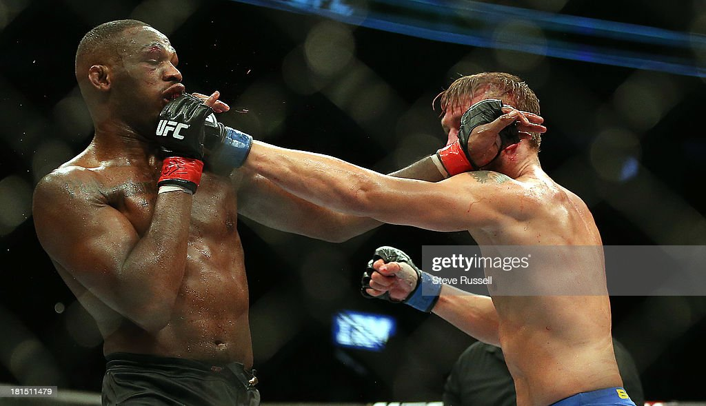 TORONTO, ON- SEPTEMBER 22 - Light Heavyweight <a gi-track='captionPersonalityLinkClicked' href=/galleries/search?phrase=Jon+Jones+-+Mixed+Martial+Artist&family=editorial&specificpeople=8928306 ng-click='$event.stopPropagation()'>Jon Jones</a> retains his Light Heavyweight title against Swede Alexander Gustafsson at UFC 165 at the Air Canada Centre in Toronto, September 22, 2013.