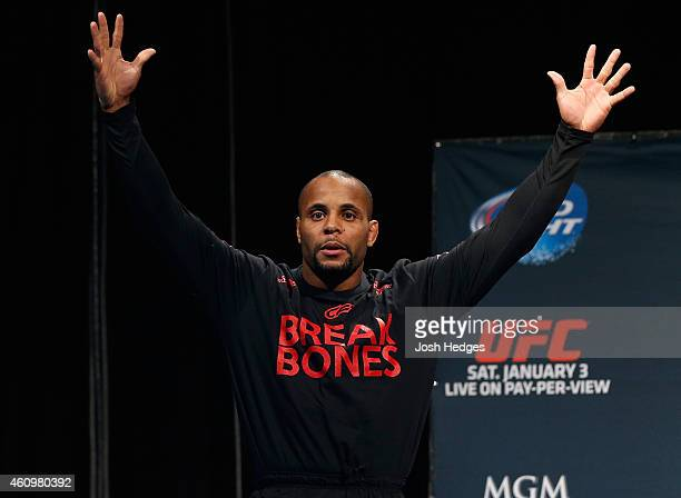 UFC light heavyweight title challenger Daniel Cormier prepares to step on the scale during the UFC 182 weighin event at the MGM Grand Conference...