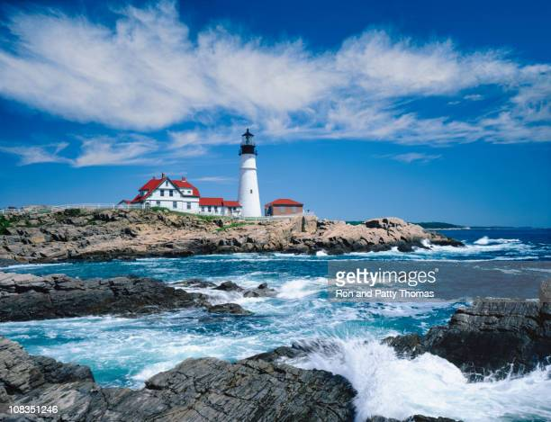 A light house on a rocky cliff in Portland