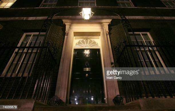 A light illuminates the door to 10 Downing Street the historic home and office to the British Prime Minister on the eve of the 10th anniversary of...