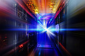 light indicators and motion on mainframe data center in the dark