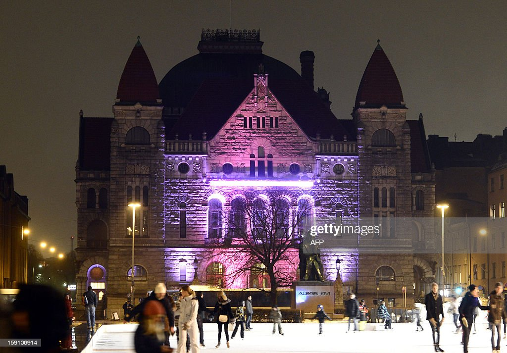 A light installation illuminates the National Theater during the Lux Helsinki festival in Helsinki, Finland on January 7, 2013. Thirteen light installations will light up a route stretching from the Olympic Stadium to Baana via the Amphitheater at the Finnish National Opera, Hesperia Park, Kansalaistori and Kiasma. AFP PHOTO / JARNO MELA /FINNLAND OUT