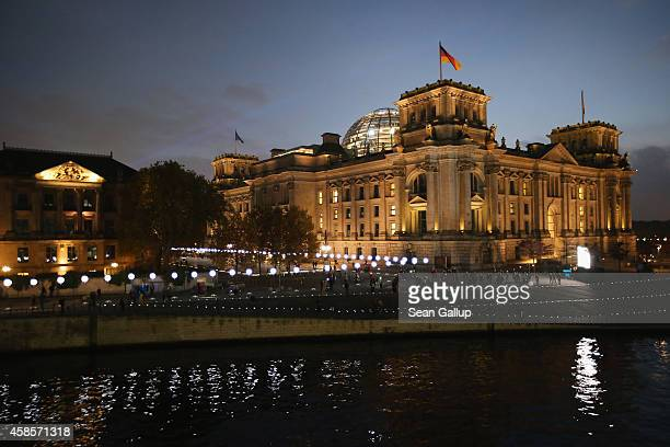A light installation of balloons tethered to lamps illuminates the course of the Berlin Wall near the Reichstag two days before the 25th anniversary...