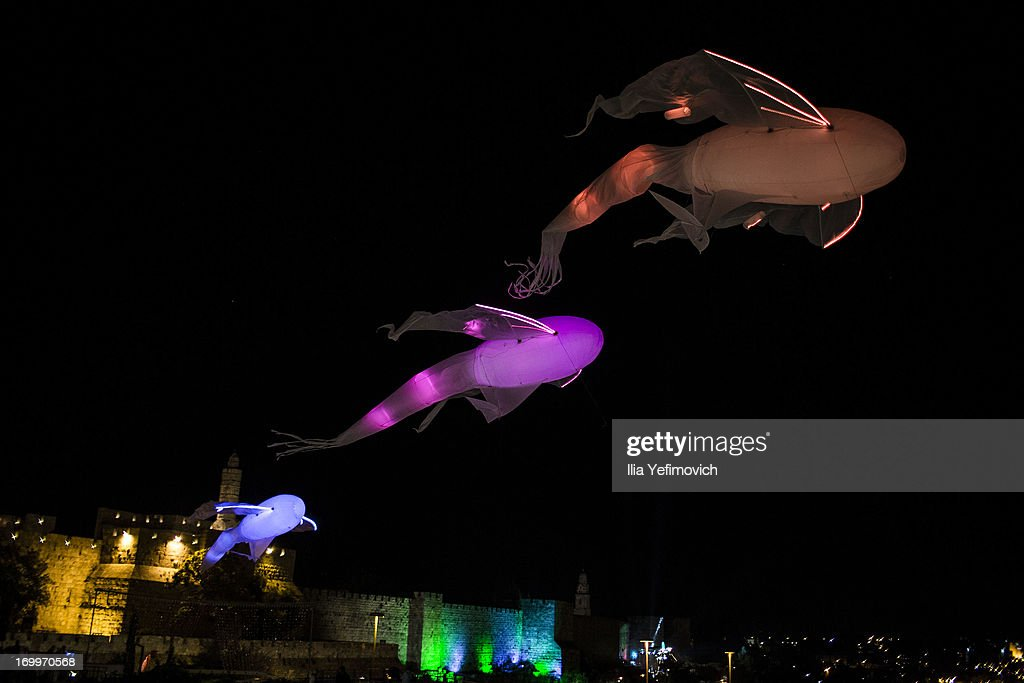 Light Installations fly above the walls of the Old City during the annual Jerusalem Festival of Light on June 5, 2013 in Jerusalem, Israel. During the festival light installations are projected onto the historic buildings of Jerusalem's Old City.
