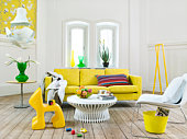 A light living room with yellow details, Sweden.