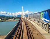 Light metro rapid transit commonly referred to as the Skytrain crosses over the Fraser River on The Canada Line Bridge The Canada Line connects over...