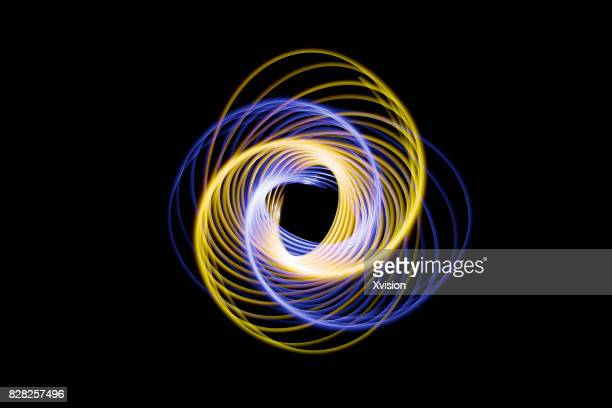 Light painting physicis swing in black background