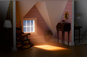 Light passing through attic window of model house, close-up