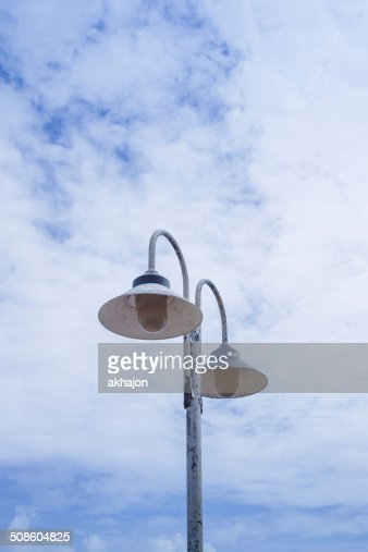 Light post on clear blue sky background : Stock Photo