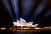 A light projection illuminates the Opera House during the official opening party of the Vivid Sydney Festival at the Overseas Passenger Terminal on...