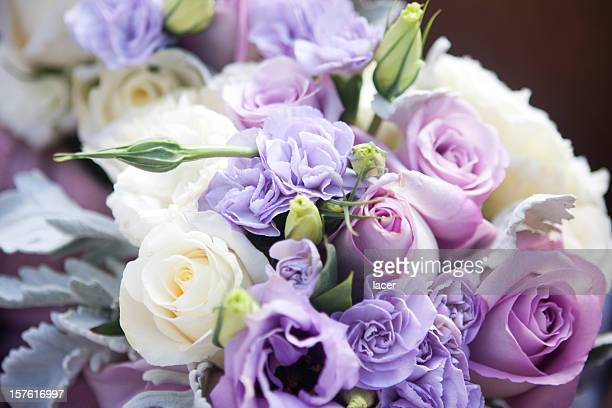 Light purple and white roses in wedding bouquet