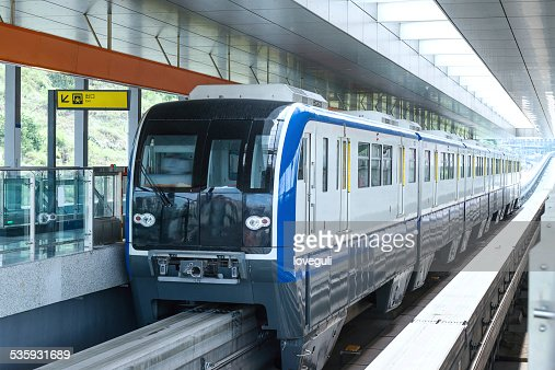 light rail train in station platform : Stock Photo