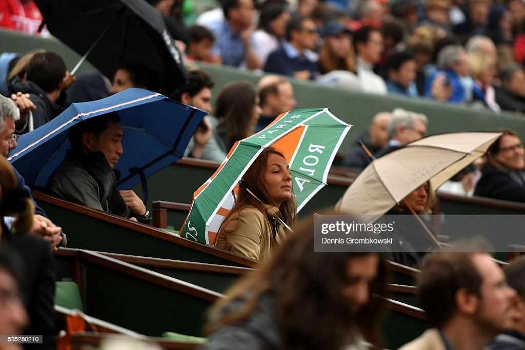 Light rain falls during the Men's Singles fourth round match between Viktor Troicki of Serbia and Stan Wawrinka of Switzerland on day eight of the 2016 French Open at Roland Garros on May 29, 2016 in Paris, France.