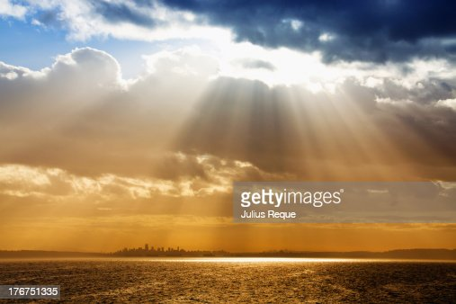 Light Rays From Clouds Above the City