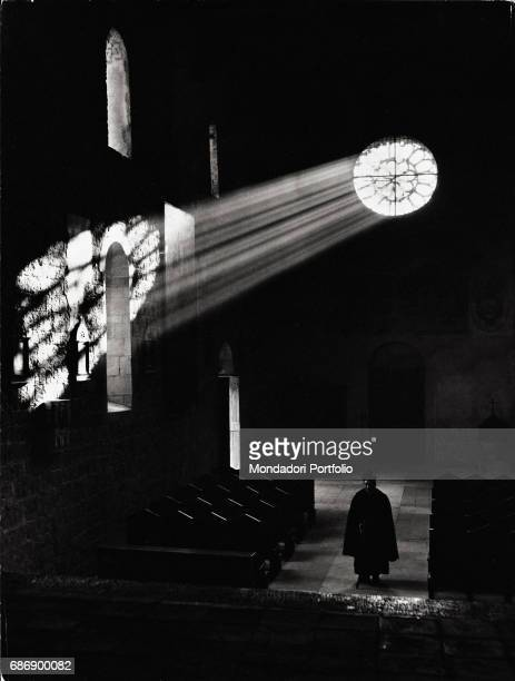 Light reflecting on a church wall through a rose window This picture is taken from the monography 'Mario De Biasi Il mio sogno Š qui' curated by...