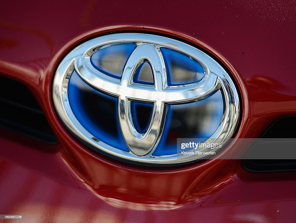 Light reflects off a Toyota emblem on a vehicle on January 30, 2013 in Los Angeles, California. Toyota is recalling more than one million vehicles sold in the United States over faulty airbags and windshield wipers.