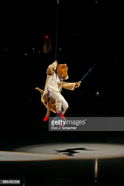 A light saber equipped Florida Panthers Mascot Stanley C Panther repels down a rope in Star Wars Jedi regalia prior to the Florida Panthers hosting...